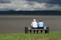 Feeling blue (lilgreentreefrog1) Tags: sea people bench couple sitting moody view cloudy cumbria sit chatting seated ulverston peoplesitting canalhead