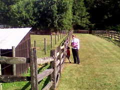 Heather & kids looking at a donkey, Upper Schuylkill Valley Park (cropped)