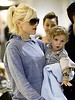 7. Gwen Stefani scoops up her favorite travel companion, 14-month-old son Kingston, as she arrives in Brisbane, Australia