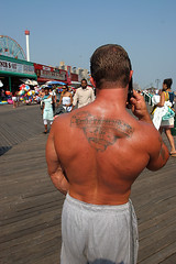 Muscular man's tattooed back on Boardwalk (DawnOne) Tags: ocean life from new york nyc travel sea summer beach tattoo brooklyn underground island photography pier sand unique character united save canadian exhibition atlantic national developers boardwalk states coney gentrification preserve iv 3807 luvd