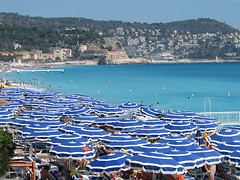 Sea of blue (**Anik Messier**) Tags: holiday france beach vacances nice bravo searchthebest ctedazur parasol umbrellas plage soe 2007 frenchriviera themoulinrouge blueribbonwinner abigfave shieldofexcellence tornadoaward theperfectphotographer