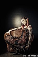 Alice in Wond...I'm not sure... (Boris Untereiner) Tags: portrait woman girl dark studio dress alice flash expressive emotional tatoo armchair wonderland ambiance strobist
