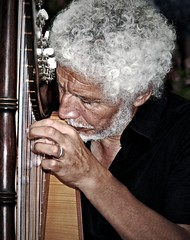 Quebec Street Musician (JakeBrewer) Tags: street music canada musicians quebec quebeccity curlyhair 2010 harps streetmusician whitehair harpists 5for2