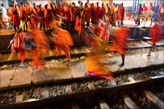 Flying the rails (Elishams) Tags: india station women traditional faith religion culture rail devotion hindu hinduism pilgrimage pilgrim inde pilgrims bihar pelerin  sultanganj flickrsbest indedunord colorphotoaward 50millionmissing bolbam sultangange sultangang