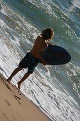 246 (uscgirlnot) Tags: waves sunsetbeach skimboarding