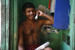 Calling Home | Kolkata (Rohit Markande) Tags: india man color smile mobile happy labor telephone lifestyle communication indians laborer kolkata puja durgapujo bengalis westbengal landline callinghome