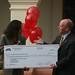 Elizabeth Freeman present check to Jason Smith, CEO American Red Cross Ventura County