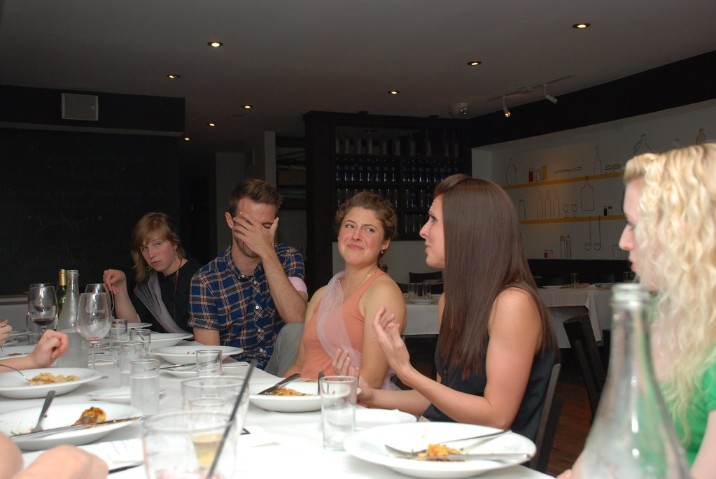Kassandra telling a story, Sierra wincing, David covering his face