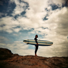 take me to the monster waves.. (czuczy) Tags: sky clouds holga rocks amy surfboard cooler fistral