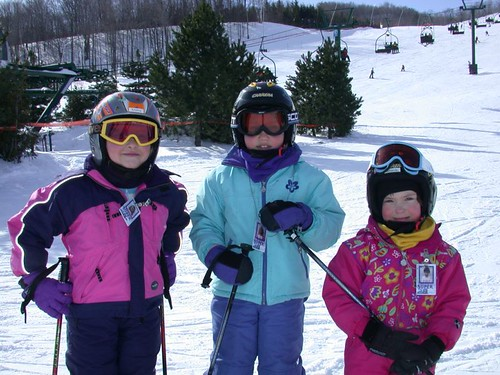 Caption: A group of young skiers pose for a photo in Blue Mountain, Ontario