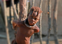 Portrait of a Himba child - Namibia (kryyslee) Tags: world pictures voyage africa trip travel portrait color travelling colors face canon southafrica photography eos photo gesicht foto tour child faces image photos pics couleurs african picture culture images tribal du adventure safari round afrika around tribe christophe monde ethnic backpacker amateur pict namibia autour couleur tribo indigenous visage himba afrique ethnology tribu aroundtheworld aventure namibie visages tourdumonde 50d tribus ethnie 400d eos400d kryyslee christophepaquignon paquignon