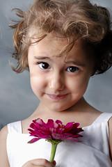 Flower Girl (jwielf) Tags: light summer flower cute girl smile clouds nikon little flash speedlight strobe d80 strobist removedfromnikkorfortags onlyyourbestshots