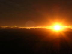 Accecami (Tatifollia) Tags: light sunset italy panorama orange sun mountains nature yellow montagne reflections dark evening italia tramonto natura giallo sole riflessi luce marche arancione sera imbrunire ripatransone penombra tatianabiancucci tatifollia