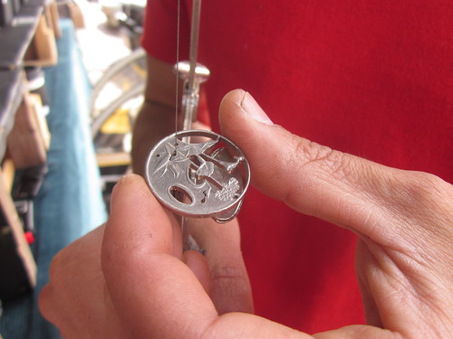 The distillery district arts market displays how he does his hand crafted coin art from recycled coins and also makes jewellery