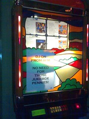 A jukebox with a sheet of A4 explaining that it's not worth putting in money.