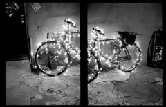 West Village, NYC. (Brian Maryansky) Tags: christmas nyc film bike bicycle pen lights diptych westvillage olympus half halfframe penft tx400 olympuspenf