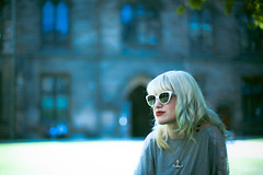 Shona (TGKW) Tags: red portrait people woman white reflection girl sunglasses university day sitting glasgow candid sunny jewellery lipstick westwood quadrangle pendant shona vivienne 9797