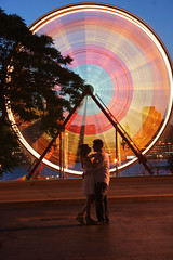 Engage in spinning, it is more fun that way (Gordana AM) Tags: carnival wedding light boy two woman ontario canada man girl wheel festival horizontal night circle out fun lights freedom engagement couple shoot riverside action pair spin trails ferris celebration windsor riverfront activity whirl class2010 lepaifgeo