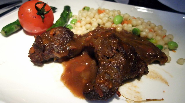 Braised Veal Cheeks with Vegetable Pearl Cous Cous, Asparagus and Vine Ripen Tomatoes