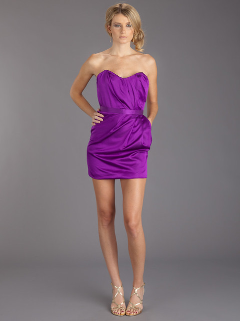 Heidi Klum wore this purple mini dress by SeenOn.com