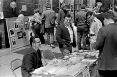 052970 19 05 (ndpa / s. lundeen, archivist) Tags: street people blackandwhite bw monochrome festival boston poster table blackwhite buttons political nick crowd may charles fair scene suit sidewalk jacket posters 1970 1970s flyers streetfair beaconhill charlesstreet dewolf nickdewolf photographbynickdewolf