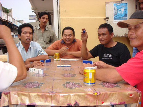 Locals playing domino. Nagoya, Batam Island, Northern Indonesia.