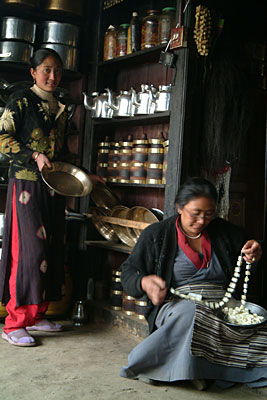 Tsering Futik Sherpa readies lunch while her mother weaves fresh churpis by Kashish Das Shrestha