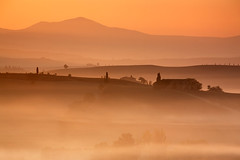 Illuminato (rgarrigus) Tags: morning autumn italy orange misty sunrise landscape twilight october europe telephoto tuscany siena backlit pienza valdorcia contrejour backlighting sfumato greatphotographers illuminato