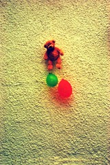 The unbearable heaviness of being (solarider) Tags: bear red blur milan green balloons teddy being dream blurred hanging todo kundera unbearable igp6467 httpwwwfacebookcomprofilephpid528866883 httpsolariderorgblog httpsurindersinghorg