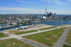 Toronto City Centre Airport Skyline (Tom Podolec) Tags: city urban toronto ontario canada tower skyline cn canon island islands airport downtown shot shots centre aerial helicopter dslr gta runway 30d blogto torontoist runways allrightsreserved cytz ytz news46 img1032258s 200706281017070001 thisimagemaynotbeusedinanywaywithoutpriorpermission 20062008