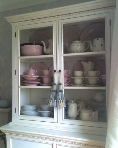 White cabinet with pink china, via Flickr: Snowdrops in Spring