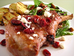 Pork chops with pomegranate sauce topped with cranberries and feta (Sashertootie) Tags: closeup dinner recipe pork homemade chops
