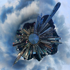 Planet Hong Kong (Jim Boud) Tags: ocean china camera travel blue light sky panorama mountain seascape reflection building tower skyline clouds skyscraper photoshop canon lens landscape asian island hongkong eos prime shiny asia cityscape shine pacific cloudy wrap warp planet styles fixed 24mm polar dslr digitalrebel photoart digitalslr f28 ef coordinates axis hongkongisland waterscape artisticphotography partlycloudy victoriaharbour victoriaharbor asiapacific littleplanet miniplanet jimboud t2i topazadjust jamesboud eos550d kissx4