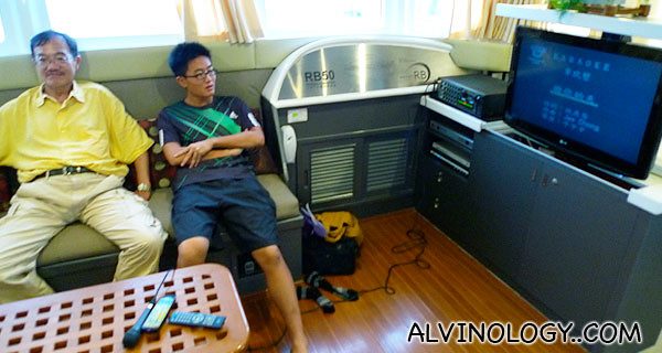 Jun Jie and my uncle lazing in the KTV room