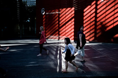 More 6 More London light (Gary Kinsman) Tags: morelondon light shadow bermondsey london canon5d canon1740mmf4l candid street photography life diagonal run little girl kid child seen fun joy se1 visible 2010 people person