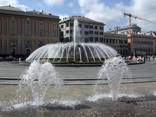 beautiful fountain and historical buildings on Piazza de Ferrari in Genoa