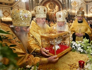 Russian Orthodox Patriarch Alexy II, second left, puts a box with holy relics from Greece's Mount Athos in Christ the Savior Cathedral in Moscow, Saturday, June 9, 2007