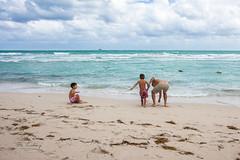 heavy hand (Otto Churchhill) Tags: ocean beach kids dad rough