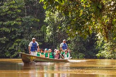 Biologists Exploring The Marvels Of  Amazon Jungle (kalypsoworldphotography) Tags: park people woman man tree southamerica nature water river happy living boat wooden ecuador amazon rainforest whitewater scenic reserve canoe explore study research evergreen national jungle vegetation editorial destination guide eco narrow climate rainfall lifejacket biological investigate scientist global cuyabeno amazonian dense amazonia organism lightweight specie