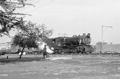 Loco YD523  |  Mirpur Khas Jn, Pakistan  |  1990 (keithwilde152) Tags: pakistan people blackandwhite monochrome station outdoor junction steam pilot 1990 locomotives khas mirpur yd523