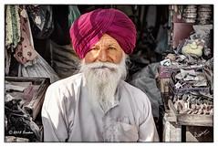 Shopkeeper (msankar4) Tags: india holy sikh gurdwara punjab amritsar trance goldentemple guru waheguru palki hymns holybook granth harmandirsahib sarover nihang tarntaran tarntaransahib sanctumsantorum granthsahib