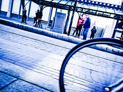 Waiting On The Streetcar Platform (TMimages PDX) Tags: road street city blue winter people urban buildings portland geotagged photography photo image platform streetphotography streetscene sidewalk photograph transportation pedestrians pacificnorthwest avenue vignette fineartphotography iphoneography