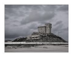 TARIFA (jonathan manasco) Tags: sky castle beach weather clouds landscape coast spain wind andalucia desaturation frame cadiz tarifa