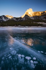 ice cracks (Donald L.) Tags: morning lake canada mountains ice glow abraham alberta cracks canadarockies icebubbles frizen