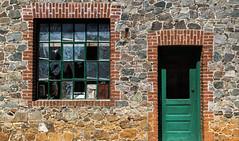 Stone and Brick (docoverachiever) Tags: california door wood old orange building brick green broken window glass stone paint grassvalley nationalregisterofhistoricplaces empiremine challengeyouwinner 70116