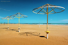 Exercise n. ... (enemene67 ...taking a break, inner rewiring) Tags: nikond5200 beach sand adriatico adriaticsea italy blue sky umbrellas ombrelloni linescurves