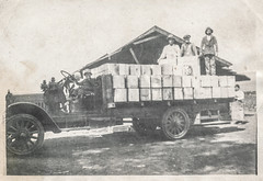 Family posing on a truck loaded with crates (simpleinsomnia) Tags: old white black monochrome kids truck vintage children found blackwhite antique snapshot photograph vernacular shipping crates foundphotograph