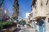 Shabbat Stroller (Allison Mickel) Tags: houses tourism israel alley nikon edited jerusalem neighborhood adobe lightroom d7000