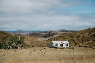 Whte Farmhouse Standing Alone