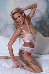 Blonde Model Pink Lingerie (lilbitrisque) Tags: sexy ass beautiful pose naughty bed model bedroom breasts tits legs boobs modeling gorgeous butt posing stomach babe curvy lingerie tattoos thighs blond booty blonde lovely tease teasing bigbreasts sexiness faketits dcups